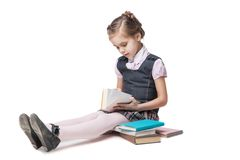 Beautiful little girl in school uniform with books Royalty Free Stock Photography