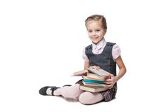 Beautiful little girl in school uniform with books Stock Photo