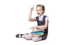 Beautiful little girl in school uniform with books stock photos