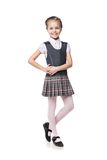 Beautiful little girl in school uniform isolated Royalty Free Stock Image