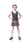 Beautiful little girl in school uniform isolated Stock Image