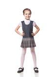 Beautiful little girl in school uniform isolated Stock Image
