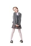 Beautiful little girl in school uniform isolated royalty free stock photos