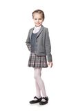 Beautiful little girl in school uniform isolated Royalty Free Stock Photo