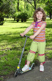 Beautiful little girl with scooter Royalty Free Stock Photos