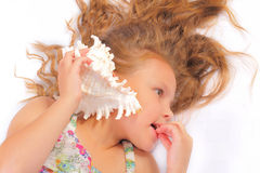Beautiful little girl with seashell Royalty Free Stock Images