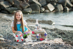 Beautiful little girl at the seaside. Stock Images