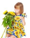 Beautiful little girl sees a beautiful yellow Stock Image