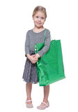 Beautiful little girl with shopping bag isolated Royalty Free Stock Photos
