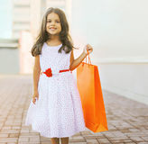Beautiful little girl with shopping bag. Beautiful little girl lady with shopping bag Stock Photography