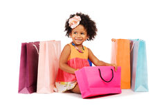 Beautiful little girl with shopping bags Royalty Free Stock Image