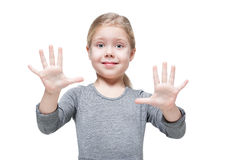 Beautiful little girl showing her hands isolated Stock Photo