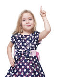 Beautiful little girl showing on something by finger  Stock Image
