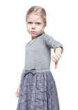 Beautiful little girl showing thumbs down isolated Stock Photos