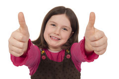 Beautiful little girl showing thumbs up Stock Image
