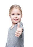 Beautiful little girl showing thumbs up isolated Royalty Free Stock Image
