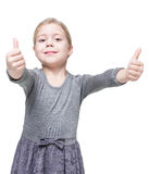 Beautiful little girl showing thumbs up isolated Royalty Free Stock Images
