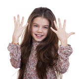 Beautiful little girl shows that she was nine years old Royalty Free Stock Photography