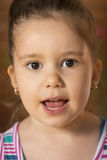 Beautiful little girl singing Stock Photography