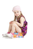 Beautiful little girl sitting on birthday gift box Stock Photos