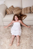 Beautiful little girl sitting on carpet Royalty Free Stock Photography