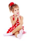 Beautiful little girl sitting on the floor crossed Royalty Free Stock Photography