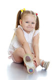 Beautiful little girl sitting on the floor Royalty Free Stock Images