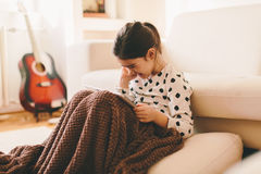 Beautiful little girl sitting on the floor with tablet Royalty Free Stock Photography