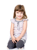 Beautiful little girl sitting in front.  on white Royalty Free Stock Photo
