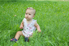 Beautiful little girl on the grass Stock Photo