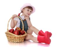 Beautiful little girl sitting next to the basket Stock Photos