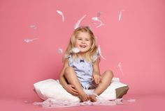 Beautiful Little Girl Sitting On Pillow . Studio Shot Royalty Free Stock Images