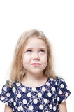 Beautiful little girl skeptically looking on something isolated. Over white background Stock Photo