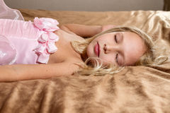 Beautiful little girl sleeping on bed Royalty Free Stock Photos