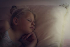 The Beautiful little girl is sleeping royalty free stock photography