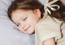 Beautiful little girl sleeping Stock Photos