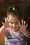 Beautiful little girl smeared with flour Royalty Free Stock Images
