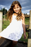 Beautiful little girl smile. Six year old girl having a great time in an outdoor park Stock Photos