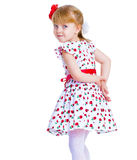 Beautiful little girl with a smile jumping. On white background Royalty Free Stock Photo