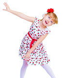 Beautiful little girl with a smile jumping. On white background Stock Photo