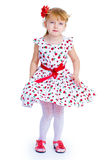 Beautiful little girl with a smile jumping. On white background Royalty Free Stock Image