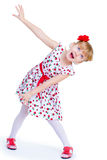Beautiful little girl with a smile jumping. On white background Royalty Free Stock Photography