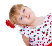 Beautiful little girl with a smile looking. Isolated on white Royalty Free Stock Photo