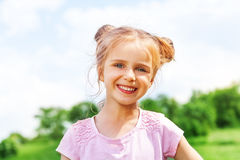 Beautiful little girl smiles at camera Royalty Free Stock Images