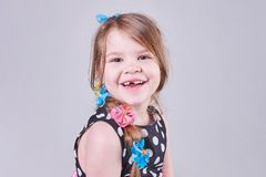 Beautiful little girl smiles a toothless smile. For all purposes royalty free stock photo