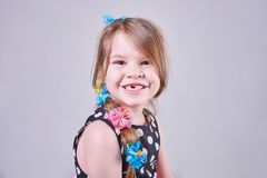 Beautiful little girl smiles a toothless smile. For all purposes Stock Photo