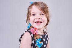 Beautiful little girl smiles a toothless smile. For all purposes Royalty Free Stock Photos