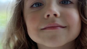 Beautiful little girl smiling close-up stock footage