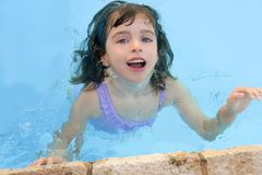 Beautiful little girl smiling in pool Royalty Free Stock Image