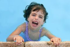 Beautiful little girl smiling in pool Stock Photos